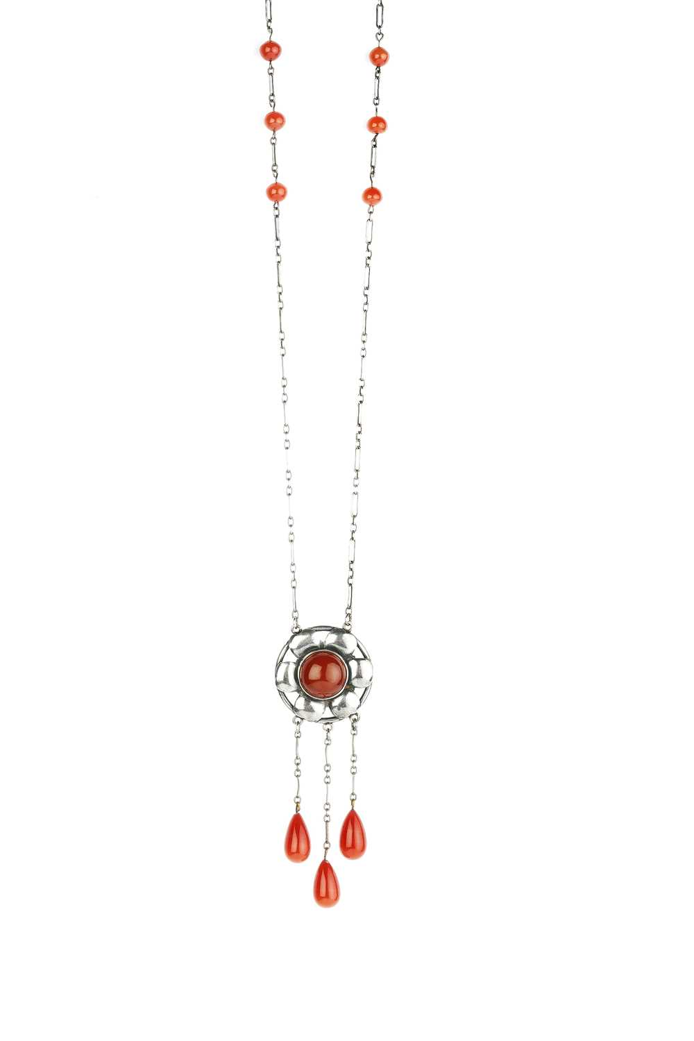 An Arts and Crafts pendant necklace, the openwork flowerhead panel centred with a red paste - Image 2 of 5