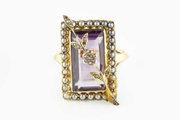 An amethyst and half pearl panel ring, the rectangular step-cut amethyst applied with a half pearl