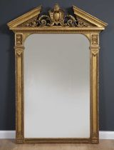 A large George III gilt pier mirror with breakarch pediment, central shield motif flanked by