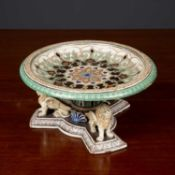A continental pottery tazza in the renaissance revival style, the tazza on a triform base with