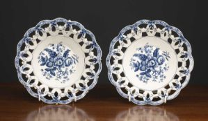 A pair of 18th century Worcester porcelain baskets decorated with fir cones and with crescent mark