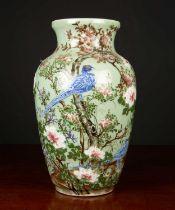 A modern Celedon glazed large baluster vase decorated with birds amongst prunus blossom, 25cm