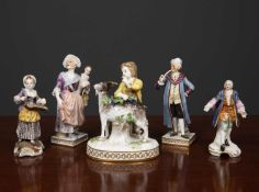 A Meissen porcelain figurine depicting and boy and a goat, 11cm wide together with a Frankerthal