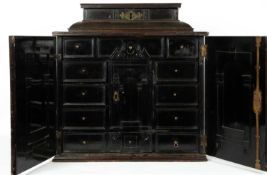 An ebony Flemish table cabinet, reputedly formerly the property of Sir Walter Scot, complete with