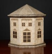 A lacquered box in the form of an octagonal house, 40cm wide x 40cm highCondition report: In good