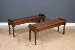 A mahogany window seat with rectangular top and turned tapering legs, 137cm wide x 33cm deep x