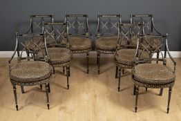A set of eight Regency style dining chairs with painted decoration on an ebonised ground, all