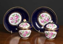 A pair of 19th century Sevres porcelain custard cups, covers and saucers decorated with pink roses