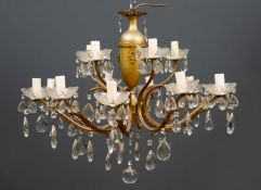 A ten branch electrolier with scrolling arms and hanging glass drops, 75cm diameter x 49cm