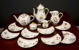 A Herend porcelain tea and coffee service consisting of teapot, coffee pot, hot water jug, milk jug,