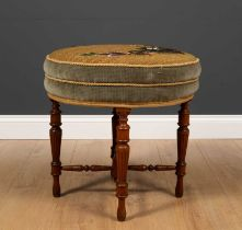 A Victorian walnut circular dressing table stool with beadwork decorated cover to the circular