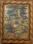A late 20th century Aubusson style verdure tapestry panel depicting countryside with a church in the