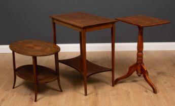 A mahogany and elm rectangular topped tripod table together with a low oval two tier occasional