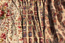 A pair of cream ground rose and sweetpea decorated curtains together with three further pairs of
