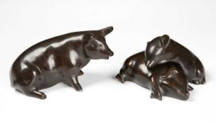 A sculptural group of three bronze pigs the largest 14cm long snout to tailCondition report: In good