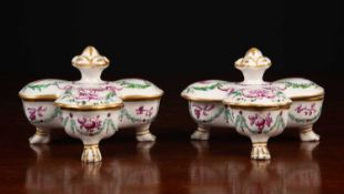 A pair of French porcelain sweetmeat dishes with rotating lids, painted with animals and figures