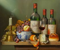 Raymond Campbell (b.1956) still life with wine bottles, fruit, cheese and a candlestick on a
