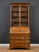 A George III mahogany bureau bookcase with astragal glazed doors to the upper section enclosing