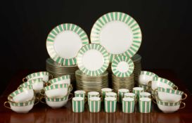 An Italian Richard Ginori porcelain dinner and coffee service decorated in gold and green in the '