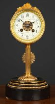 A French mantle clock the drum case on a reeded column, stepped circular plinth, the dial with