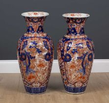 A pair of large Imari porcelain vases decorated with trees and flowers, 27cm diameter x 61cm