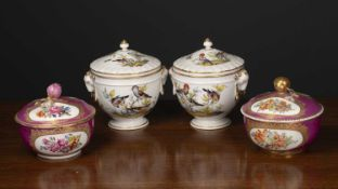 A pair of continental porcelain bowls and covers each decorated with animal masks and with bird