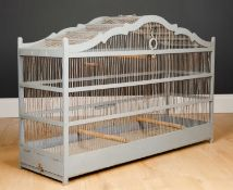 An antique grey painted bird cage on a rectangular base, 89cm long x 27.5cm wide x 56cm