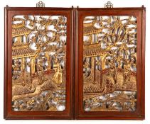 A pair of early 20th century Chinese carved and gilded wooden panels, each 32cm x 52cmCondition