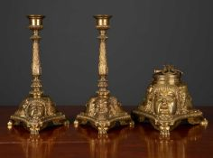 A desk set consisting of an ink stand and matching pair of candlesticks, each piece on a triform