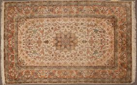 A Kashmiri cream ground rug with stylized foliate decoration, 292cm x 176cmCondition report: With