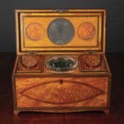 A George III satinwood tea caddy with decorative crossbanding and stringing, the fitted interior