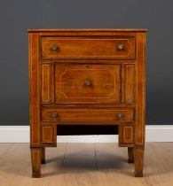 A continental mahogany bedside cabinet with satinwood stringing and with a drawer over a central