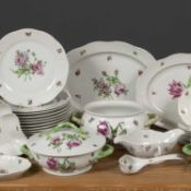 A Herend porcelain part dinner service each piece decorated with pink ornamented flowers, the