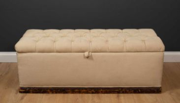An old upholstered ottoman stool with carrying handles to the ends and button upholstered lid, 125cm