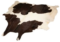 A modern black and white cow hide rug 193cm x 195cm (maximum)Condition report: Minor marks overall