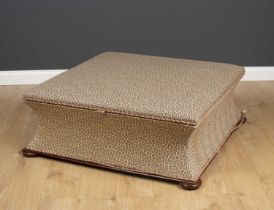 A Victorian style square ottoman stool with turned bun feet and leopard skin print upholstery, 105cm