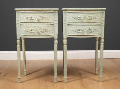 A pair of bow fronted green painted bedside tables each with two drawers and standing on turned