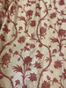 A large pair of beige or light gold ground silk lined curtains with red embroidered exotic vine