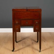 A George III mahogany wash stand with fold over top revealing recesses within, five various