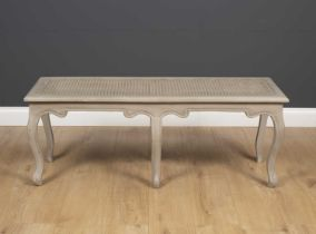 A grey painted 18th century French style window seat, with carved cabriole legs, 120.5cm wide x 40cm
