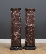 A pair of Scagliola marble columna sculpture plinths or torchieres with turned black painted bases