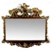 An 18th century style mahogany and gilt wall mirror, the shaped and pierced top with gilt hoho