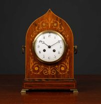 An antique French rosewood cased mantle clock the shaped case with decorative inlay, carrying
