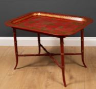 A chinoiserie style tray top table with Oriental decoration to the tray and ring turned legs to