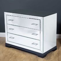 A contemporary mirrored three drawer chest with ebonised plinth base, 101cm wide x 52cm deep x 80.