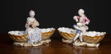 A pair of Meissen porcelain sweetmeat dishes, each with seated courtly figures preparing food,