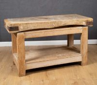 An early 20th century beech and pine rectangular butchers block on a pine stand, 153cm wide x 62cm