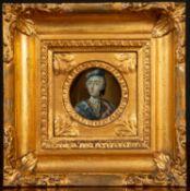 A miniature portrait of Bonny Prince Charlie, reverse glass painting, set within a decorative gilt