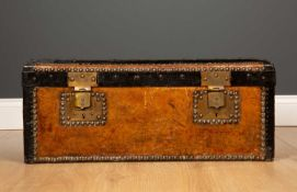 A small 19th century tan leather iron bound trunk or box 67cm wide x 33cm deep x 27cm