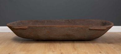 An ethnographic Pacific Island large feasting bowl in carved hardwood, with lug handles to the